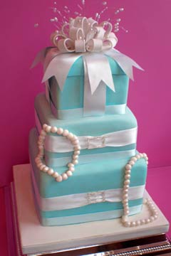 Tiffany Blue And White Three Tier Wedding Cake Decorated With Strands Of Pearls Satin
