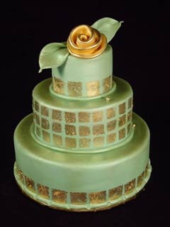 Green round, three tier retro style fondant wedding cake, decorated with gold leaf style squares