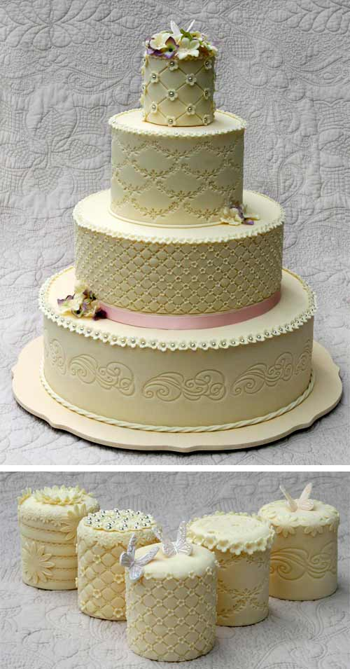 Four tier Victorian wedding cake design, in cream. Intricately decorated with mini wedding cakes to match