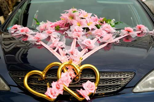 wedding car decorations - featuring two large gold hearts