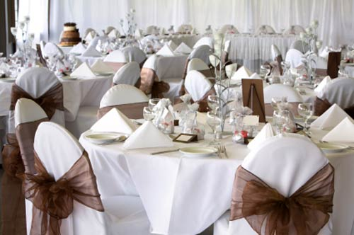 Chocolate brown coloured name cards, menu's and matching organza wedding chair covers